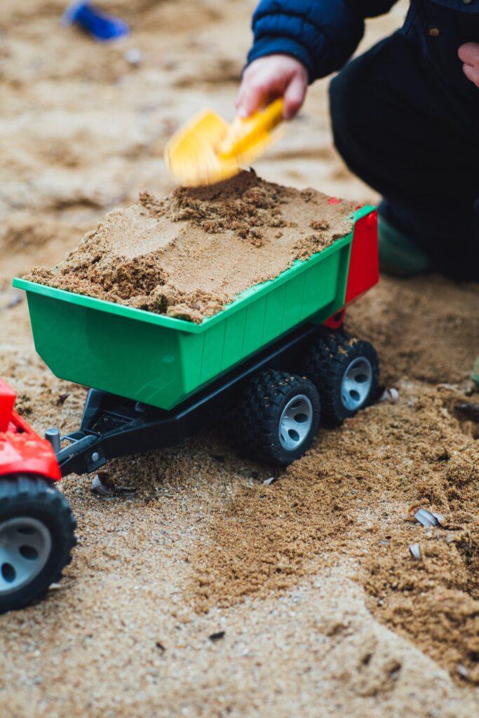 Merits Of Ride-On Kids Toys markus spiske dWaRJ3WBnGs unsplash kids toys Kid Toy Insider